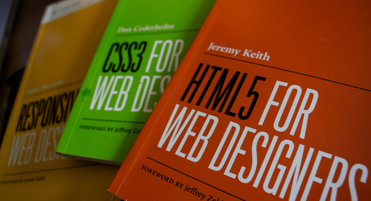 A picture of 3 web design books. Orange, Green and Yellow