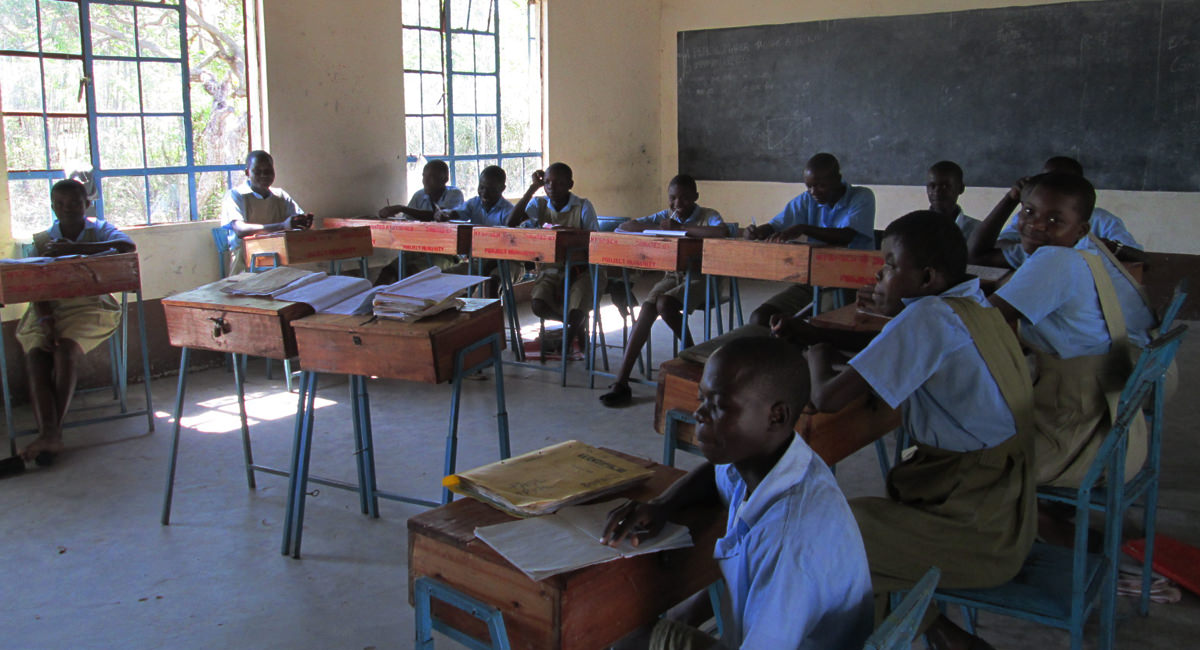Children in Africa, sat in their class room with new uniforms